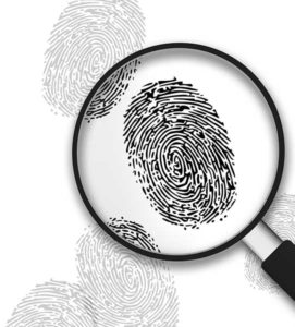 Magnifying Glass with finger prints on white background.